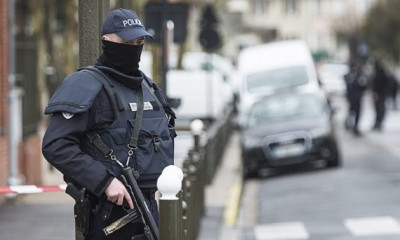 epa05230468 A police officer stands outside a building where an anti-terrorism operation took place in Argenteuil, near Paris, 25 March 2016. A terrorist attack had been thwarted in Paris with the arrest of a suspected terrorist whose plans for an attack were in an advanced state. A suspect terrorist named Reda Kriket has been arrested in Boulogne Billancourt.    and Parisians lay and Belgian flags, flowers, candles, personalised messages for victims of terror attacks in Brussels in front of the monument on Place de la Republique, Paris, France, 23 March 2016. At least 31 people have been killed with hundreds injured in terror attacks in Brussels, Belgium on 22 March, which Islamic State (IS) has claimed responsibility for the attacks.  EPA/IAN LANGSDON  EPA/ETIENNE LAURENT  EPA/ETIENNE LAURENT