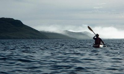 misty-mountains-and-kayak-silhouette