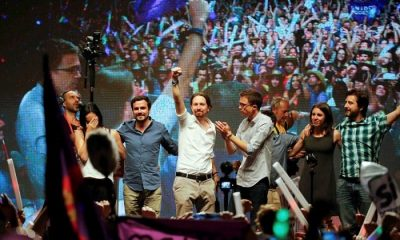 Podemos (We Can) party leader Pablo Iglesias (C) and Izquierda Unida (United Left) leader Alberto Garzon (L), running under the coalition United Podemos (Together We Can), address supporters with fellow party members after results were announced in Spain's general election in Madrid, Spain, June 27, 2016. REUTERS/Andrea Comas