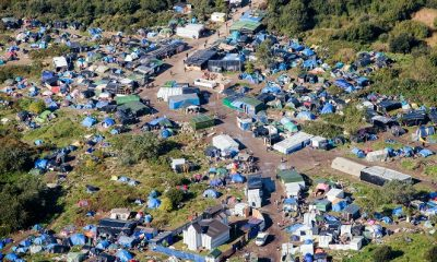 "TO GO WITH AFP STORY BY DALVID COURBET (FILES) - An aerial picture taken on October 8, 2015 shows the ""New Jungle"" migrants camp where some 3,500 people live while they attempt to enter Britain, near the port of Calais, northern France. The slum-like migrant camp sprung up after the closure of notorious Red Cross camp Sangatte in 2002, which had become overcrowded and prone to violent riots. AFP PHOTO DENIS CHARLET"