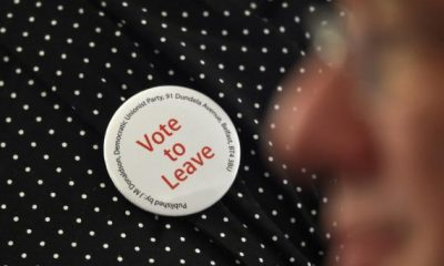 A supporter wears a Vote Leave badge during the final speech of the EU referendum campaign by Nigel Farage, the leader of the United Kingdom Independence Party (UKIP), in London, Britain June 22, 2016. REUTERS/Toby Melville