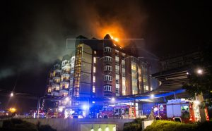 epa05563022 A general view shows firefighters arriving at the scene of a fire burning the upper floors of the Bergmannsheil hospital in Bochum, Germany, 30 September 2016. According to the fire department, two people were killed in the firefight and at least 15 others were injured.  EPA/MARCEL KUSCH