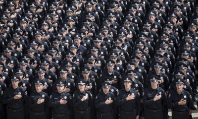 Police officers sing the national anthem during an oath-taking ceremony, which started up the work of a new police patrol service, part of the Interior Ministry reform initiated by Ukrainian authorities, in Kiev, Ukraine, July 4, 2015.  REUTERS/Markiv Mykhailo/Ukrainian Presidential Press Service/Pool