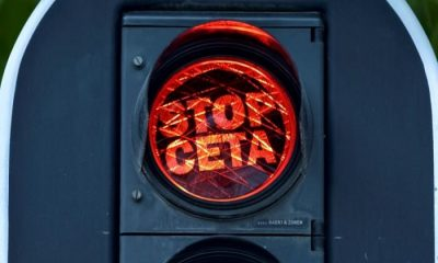 "Overlays on a red light reading, ""Stop CETA"" are displayed on traffic lights near the European Commission in Brussels, Belgium September 1, 2016. REUTERS/Eric Vidal"